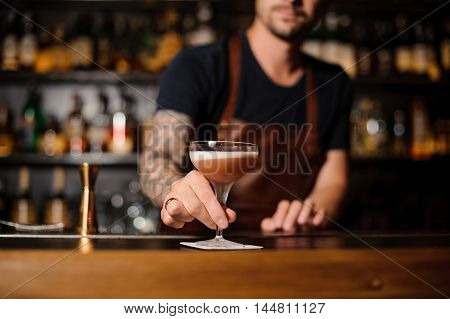 Barman at work, serving cocktails at the bar no face