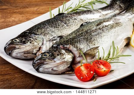 Fresh raw trout on wooden background
