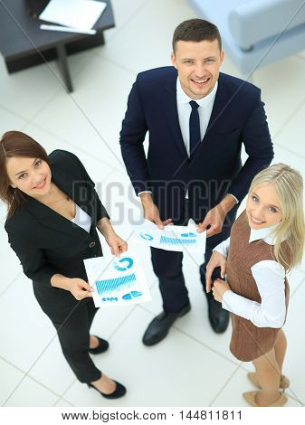 Three successful business person. High view