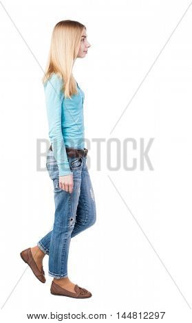 side view of walking  woman in jeans. beautiful blonde girl in motion.  backside view of person.  Rear view people collection. Isolated over white background. Girl in leather shoes are left