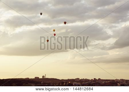 Colorful hot air balloon is flying at sunrise