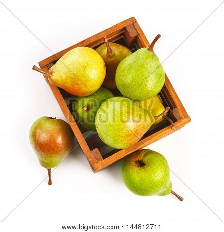 Pear ripe fruits harvest in wooden box, isolated on white background