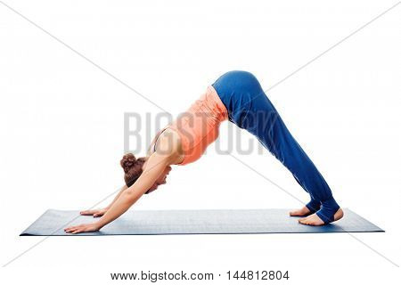 Woman doing Surya Namaskar Ashtanga Vinyasa Yoga asana Adho mukha svanasana - downward facing dog isolated on white background