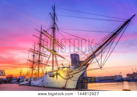 Sailboat in Gdynia harbour at sunset, Poland