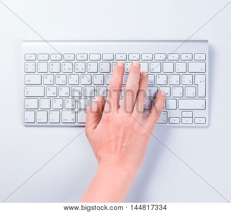 Close-up of typing female hand on keyboard
