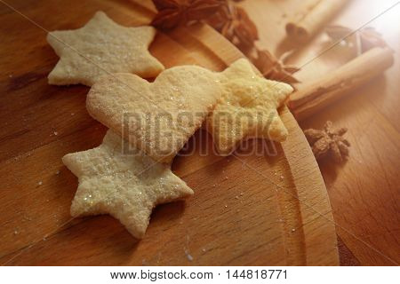 cookies stars heart cinnamon star anise on wooden background