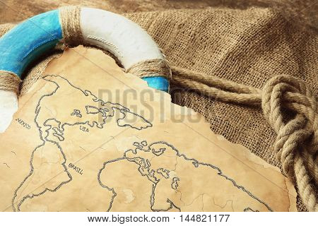 Lifebuoy with old map. Happy Columbus day concept. Happy Columbus day concept