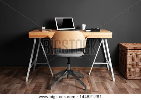 Working place on gray wall background