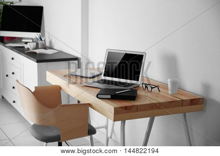 Working place on white wall background