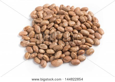 Raw Carioca Beans close-up in white background