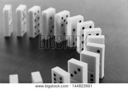 Dominoes standing on gray background