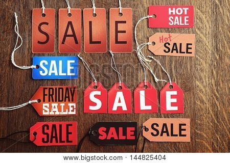 Sale label on wooden background