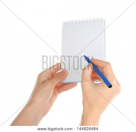 Hand holding notepad and pen on white background