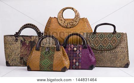 Set of beautiful wicker women handbags isolated on white background