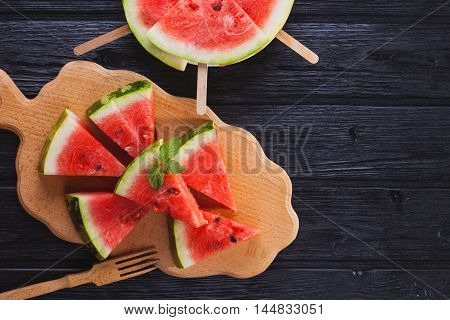 Top view healthy watermelon on the wooden background.