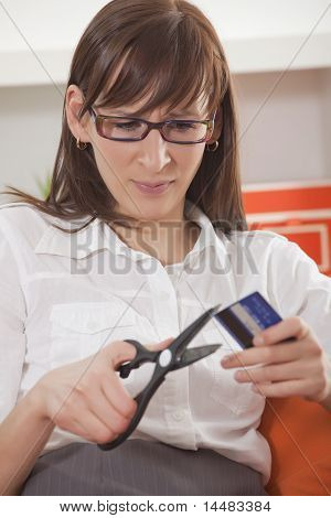 Woman Cut Credit Card