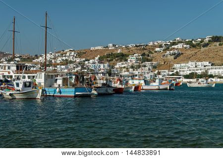 Mykonos, Greece (Chora) - Little boats on the old port beach. The beach before the town hall. Mykonos town visible in the background.