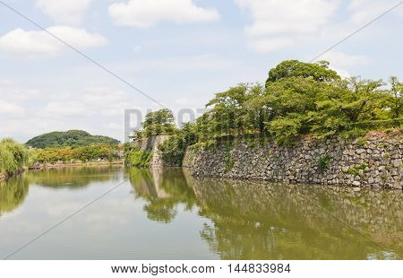 Moat and stonewall (ishigaki) of Himeji castle (White Egret Castle 1609). Himeji-jo is National Treasure of Japan and UNESCO World Heritage Site