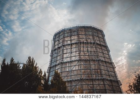 Large factory chimney of slate in a cloudy morning
