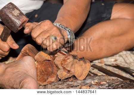 Hands Working And Carving Wood Close Up