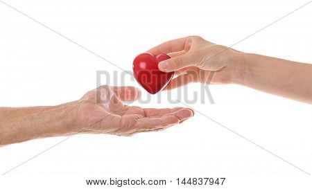 Old male and young female hands with heart figure on white background