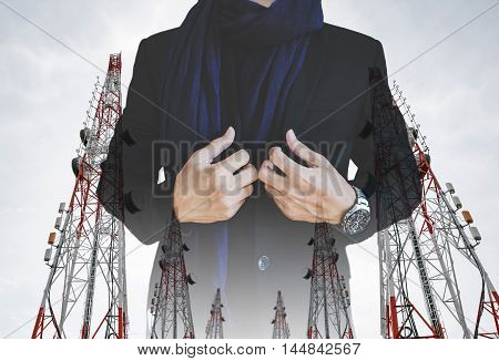 Businessman in casual suit with multiple exposure Telecommunication towers with TV antennas and satellite dish