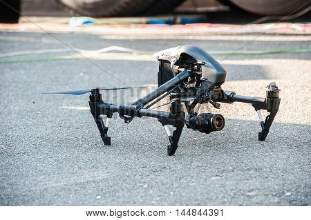 Drone with professional camera on ground.Selective focus