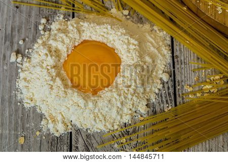 Cooking Spaghetti On A Wooden Background Milk Eggs