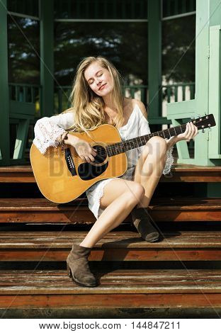 Girl Playing Guitar Outdoors Summer Concept