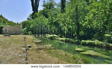 The landscape near Roski Slap waterfall showing a small tributary of the River Krka in Krka National Park Sibenik-Knin County Croatia.