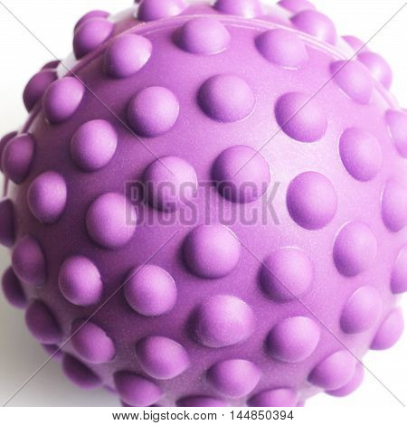 Rubber sensory ball of bright color isolated on white