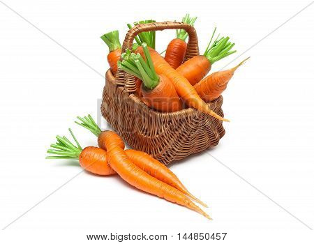 mature carrots in a wicker basket on a white background close-up. horizontal photo.