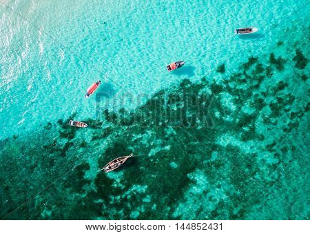 beautiful top view of clear turquoise ocean with many boats