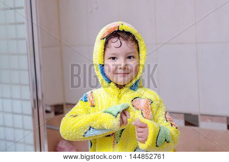 boy in a robe after a shower