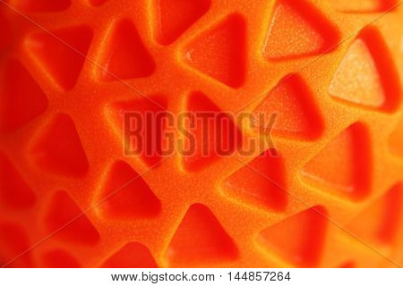 Orange rubber texture with triagle pattern close up bright