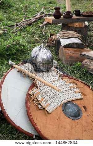 vintage large wooden shield and armor with battle axe and part of everyday life of the medieval soldier