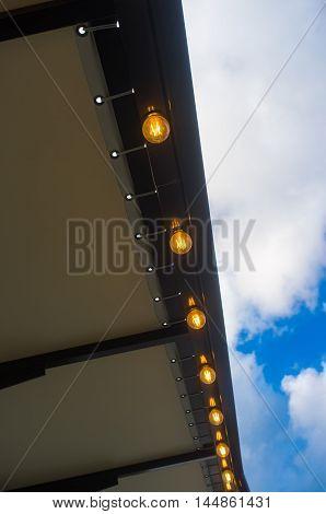 Decorative antique style filament light bulb outdoors