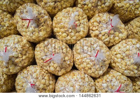 Background of large bags filled with movie theater popcorn