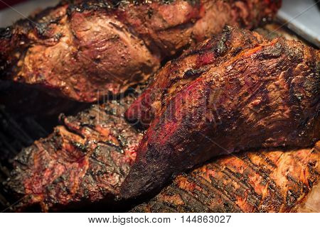 Grilling large juicy beef steaks for summer barbecue
