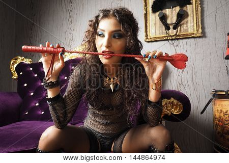 Mistress do master roleplay with her whip and chain over slaves