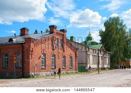 LAPPEENRANTA, FINLAND - AUGUST 8, 2016: People walk near Orthodox parish building and church priest house. Last Fortress territory.