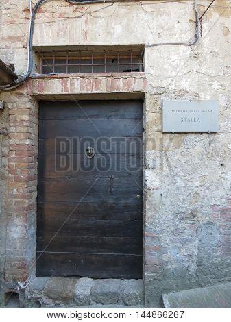 Old Wood Door In Siena