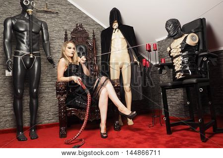 Mistress play with slave model in the bdsm room