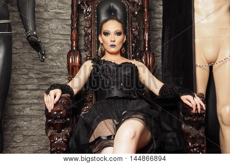 Mistress on the baroque chair make playrole