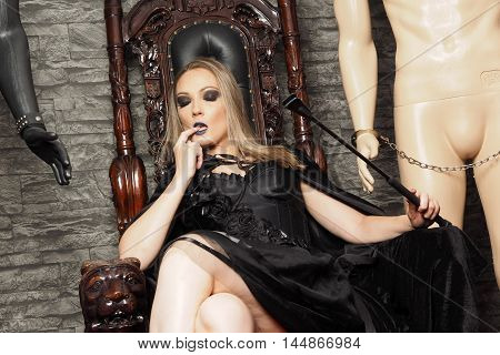 Mistress do dominant role in master roleplay with slave model