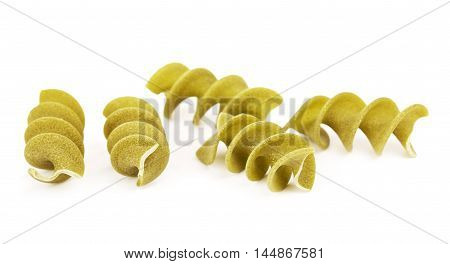 raw green spiral pasta fusilli, isolated on white