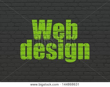 Web design concept: Painted green text Web Design on Black Brick wall background
