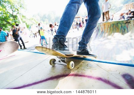 Man riding on a skateboard. Skatepark. In motion