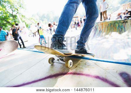 Man riding on a skateboard. Skatepark. In motion