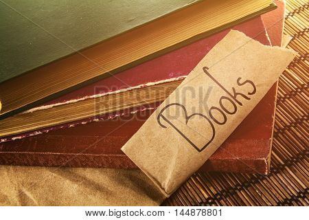 Old vintage books with text on warm background
